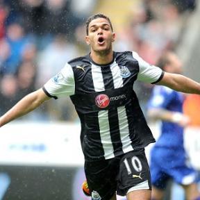 Hatem Ben Arfa celebrates after scoring against Bolton
