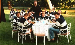 A telling divide: Hiddink, startled, stands up from his seat at the middle table as a journalist, unexpectedly, snaps the squad eating lunch during Euro '96, with only Richard Witschage sitting with the black members of the squad
