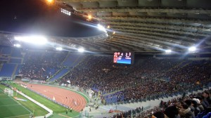 The AC Milan supporters on the left, their tormentors on the right
