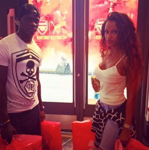 Mario Balotelli poses for a picture beside an Arsenal crest